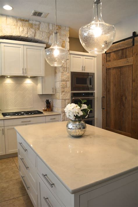 We replaced the gold speckled granite with a creamy