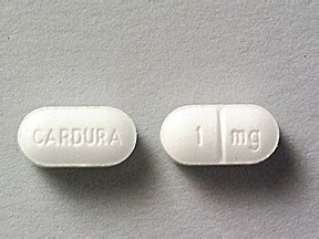 CARDURA 1 mg Pill Images (White / Elliptical / Oval)